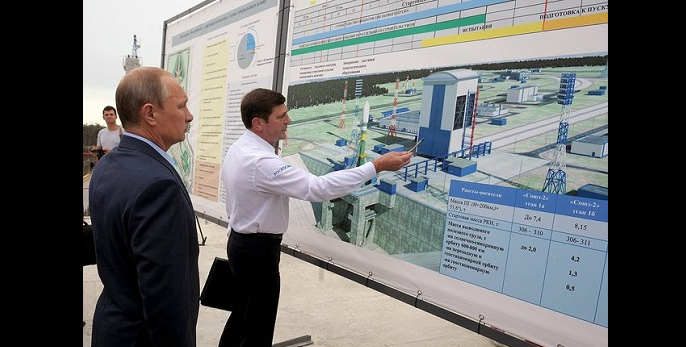 Vladimir Putin reviews the plan for the Vostochny spaceport. Credit: Presidential Press and Information Office
