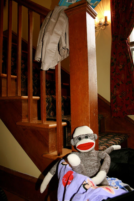 sock monkey on stairs
