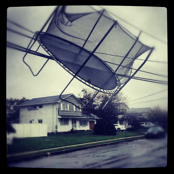 Hurricane Sandy hangs trampoline up in utility cables.