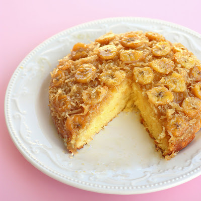 This Banana Coconut Upside Down Cake has a layer of bananas and coconut with a brown sugar sauce infusing every bite. the-girl-who-ate-everything.com
