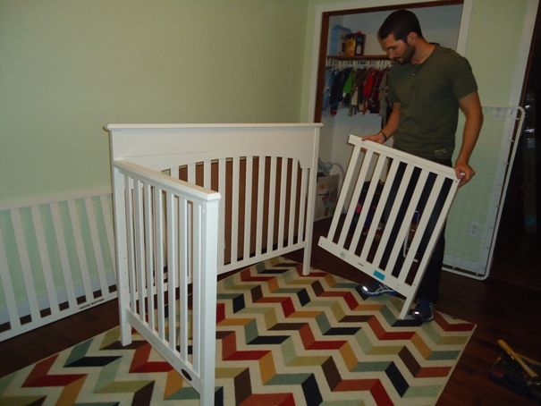 Putting the crib together one piece at a time