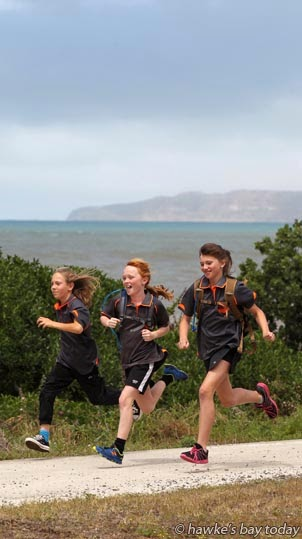 L-R: Tessa Burns, Frances Rainbow, Lauren Swift, 11 year-olds from Haumoana School, Haumoana, running on the Rotary Pathway, along Beach Rd, Haumoana, training for last weekend's Cape Kidnappers Challenge, sponsored by Gannet Beach Adventures, with Cape Kidnappers in the background. photograph
