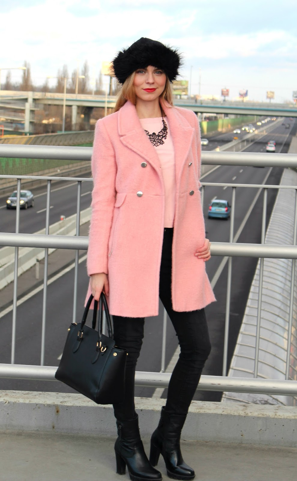 pink coat and black