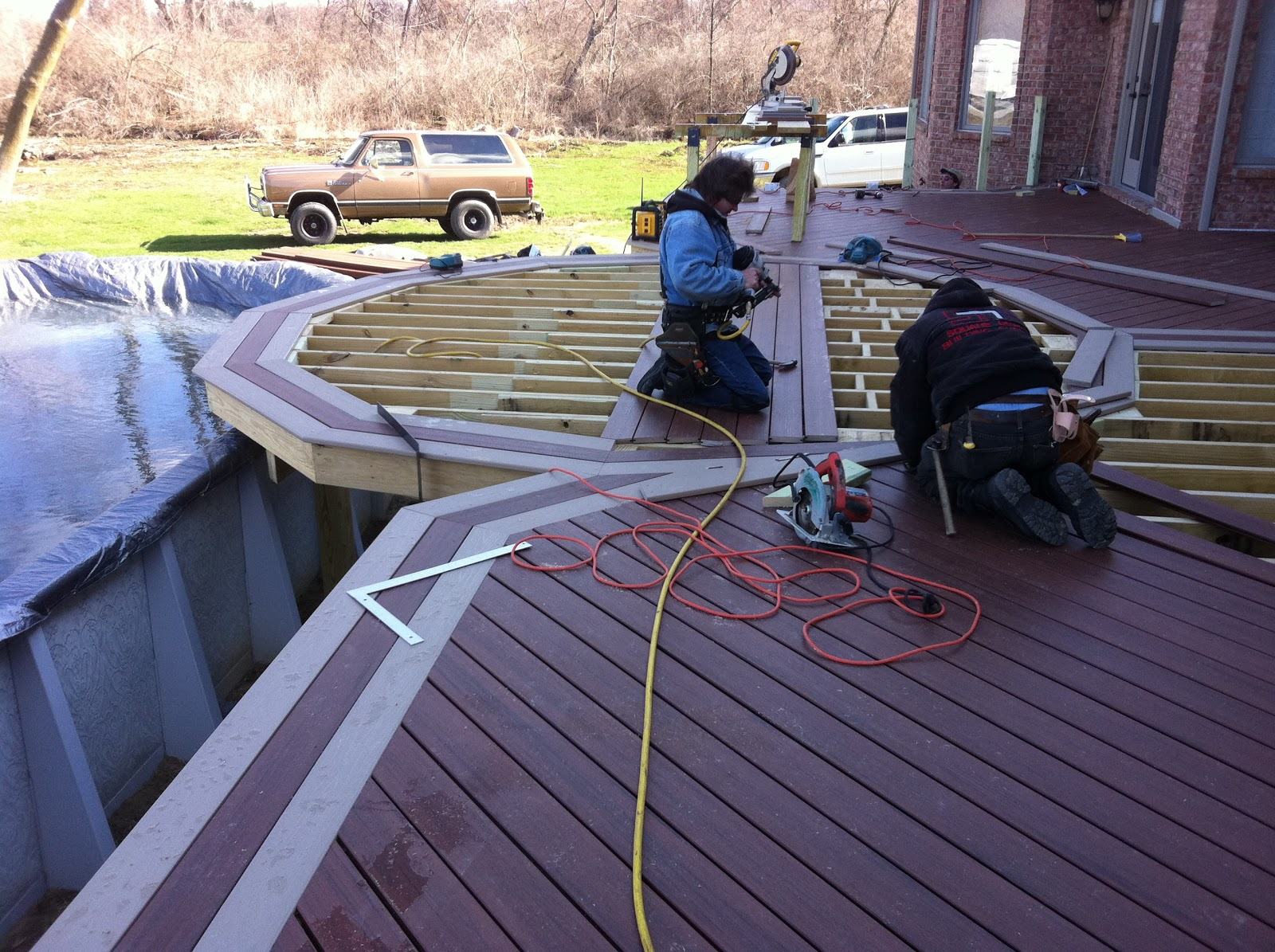 Outdoor living romeo mi composite deck for Garden decking borders