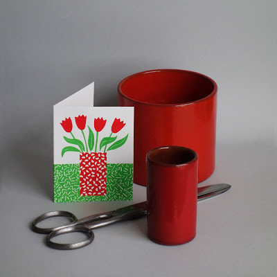 Silk-screened card, wallpaper sheers and red cylinder vases
