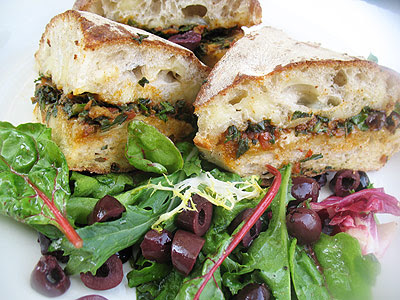 Toasted Ciabatta Sandwich with Brie, Sun-Dried Tomatoes and Pesto