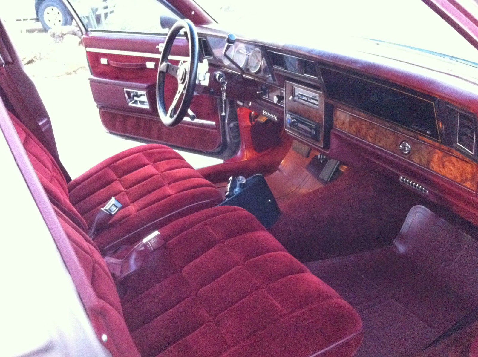 The seller has installed a gt grant steering wheel and some kind of aftermarket gauges but left the plush elmo hide seats carpet door cards alone