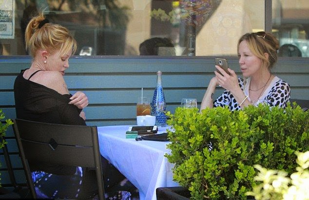 As the Dailymail.co.uk report: White grabbing a bite to eat with her female friend for lunch at a restaurant in Beverly Hills on Sunday, March 8, 2015, the actress showed off some honestly expression.  Melanie Griffith has one reminder of the last that just won't go away: a peace of meaningful sign behind her right shoulder.