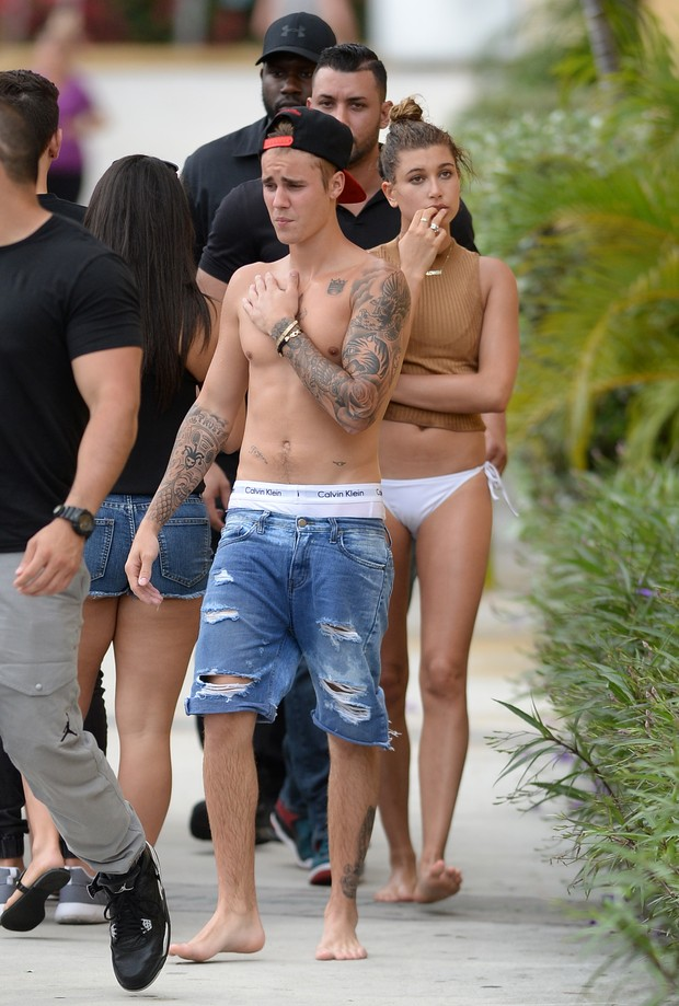 Shirtless and with underwear showing, Bieber has fun with Hailey Baldwin
