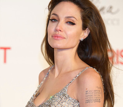 "Angelina Jolie returns in Maléfique and promises ""a very strong suite""!"