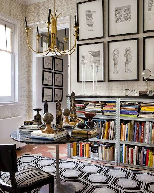 dining room with books and modern geometric patterned rug