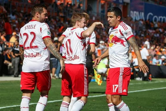 Tim Cahill celebrates with Red Bulls teammates after scoring a goal against Houston Dynamo