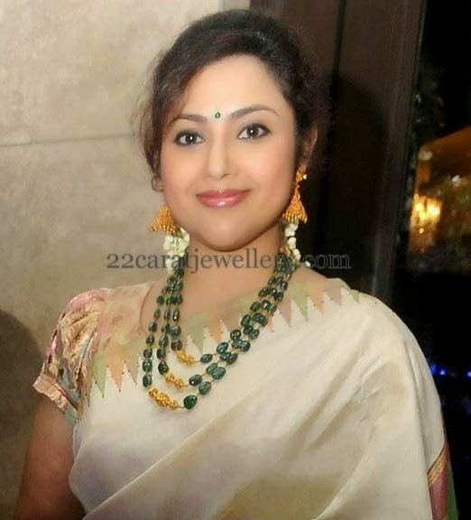 south indian actress meena wearing large emerald drops embellished