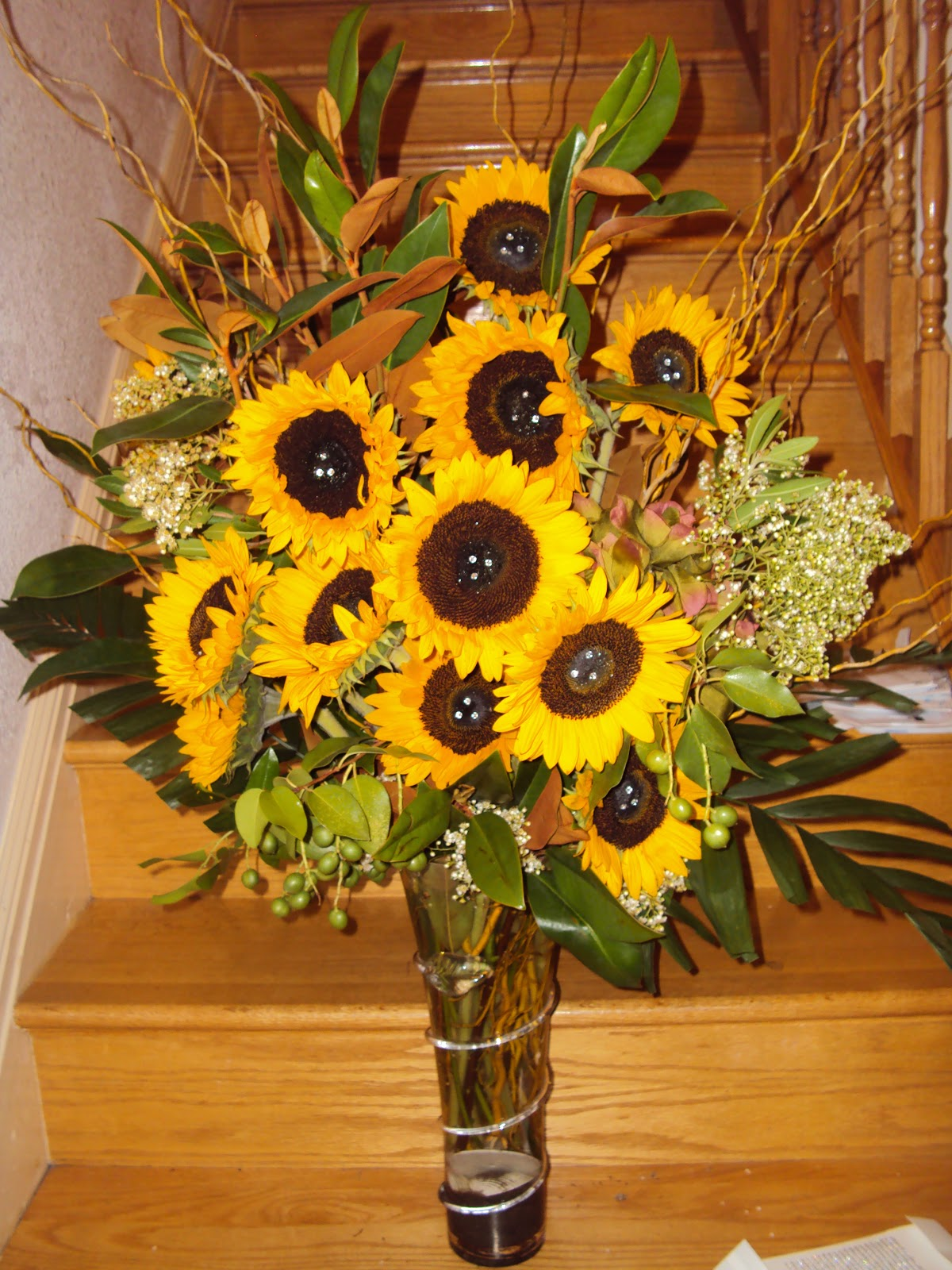 Floral arrangement sunflowers and other yellow flowers