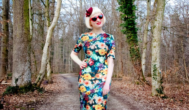 flower dress, berry fascinator, heart shaped glasses