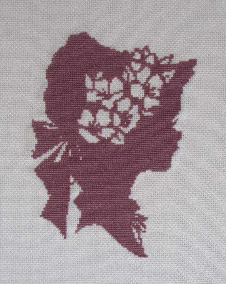 Silueta de mujer con sombrero