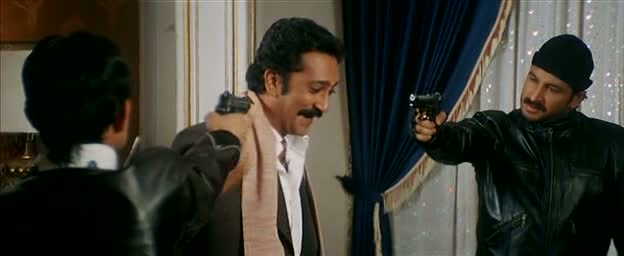 KRK and Kalia pointing guns at the bad guy