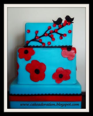 Blue and Red Modern Cherry Blossom Cake with two little love Birds on top