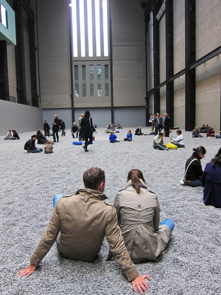 Ai Weiwei - Sunflower seeds in Tate modern (Unilever Series) Couple sitting on the porcelain seeds