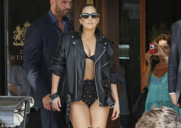 Lady Gaga wears leather hotpants, bra, and jacket out and about in Athens