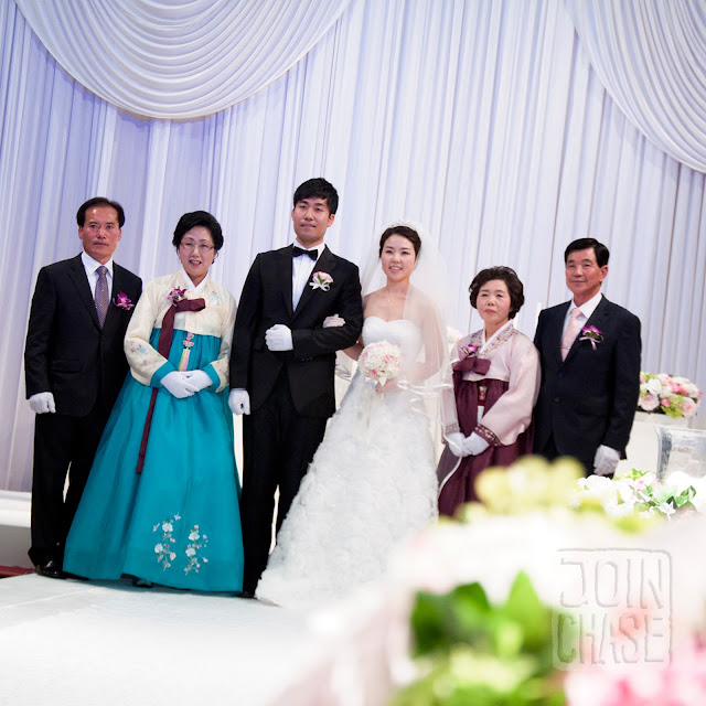 A Korean bride and groom with their families in Cheongju, South Korea.