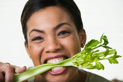 Black Woman Eating Celery