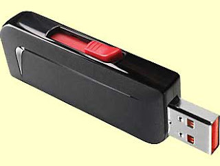 USB thumb drive, small black electronic item with silver plug on one end