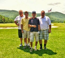 Four male golfers on the Storm King Golf Course