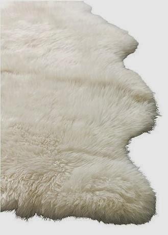Fresh twist decorating with sheepskin faux fur for Faux fur area rug ikea