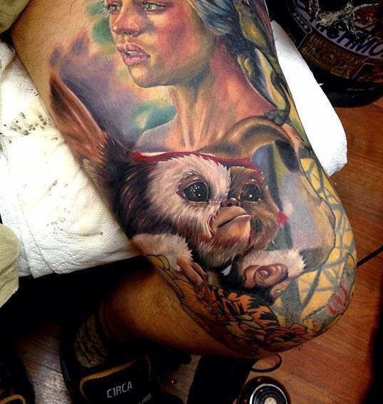 Lady and small monkey tattoo on leg