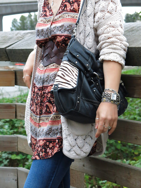 belted floral tunic, grandpa cardigan, and Fossil bag
