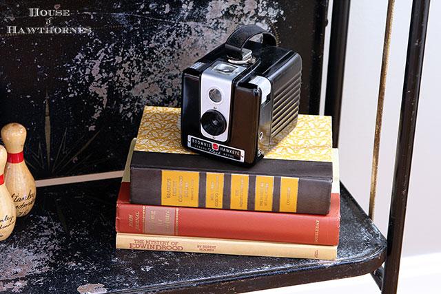 Vintage Brownie Hawkeye camera in an eclectic vintage entryway via houseofhawthornes.com