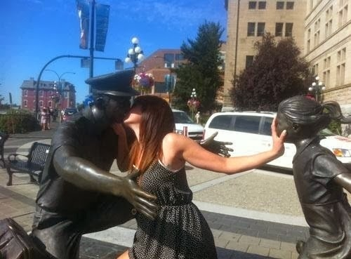 Tourist Posing Inappropriately with Statues 6