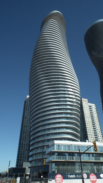 Photo of the towers as seen from the street looking up