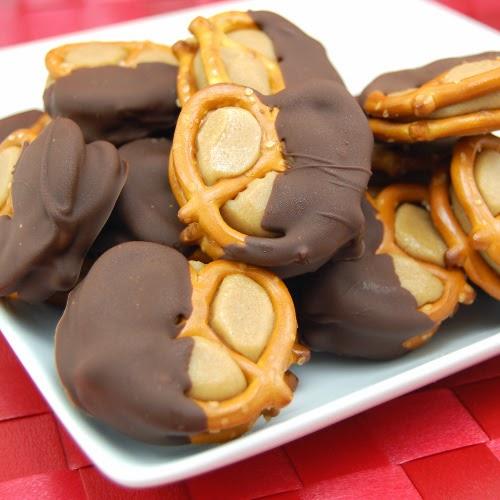 http://sweetpeaskitchen.com/2011/03/peanut-butter-buckeye-pretzel-bites/