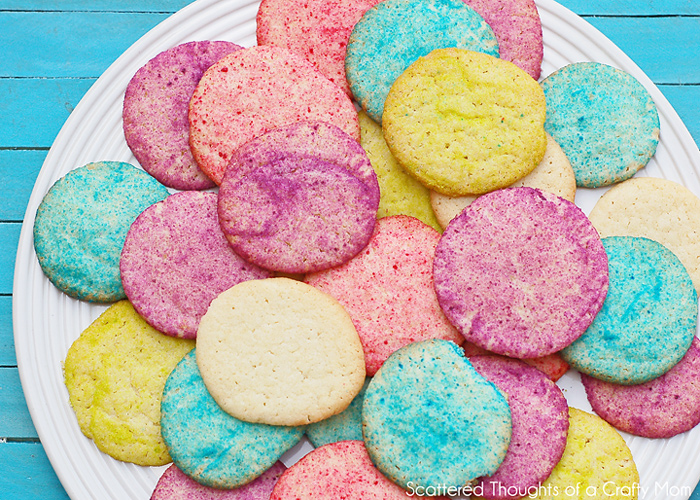 Easy Rainbow Sugar Cookies.  Perfect cookie project for kids (especially for those that dont have hours to spend in the kitchen!) #cookies #rainbows