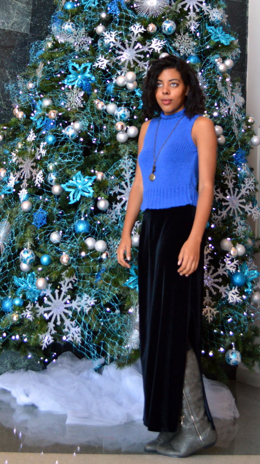Fashion Blogger Anais Alexandre of Down to Stars in a vintage blue sleeveless turtleneck with a velvet maxi skirt and grey leather boots