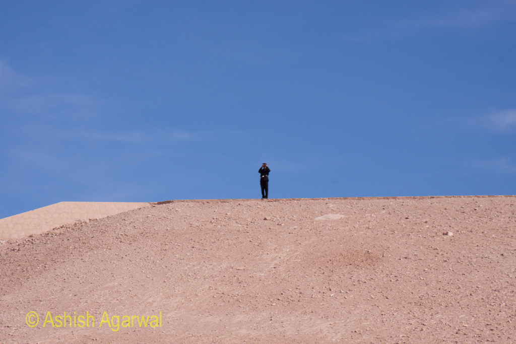 Police officer standing on a rise above the Abu Simbel temple in south Egypt