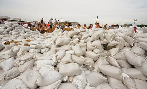 Under-insured: sandbags to try to stop flooding after extreme rainfall in the US (Credit: Jocelyn Augustino/FEMA via Wikimedia Commons) Click to enlarge.