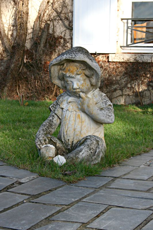 stone figure of small child