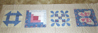 Quilt blocks laid on fabric to see how  they look.