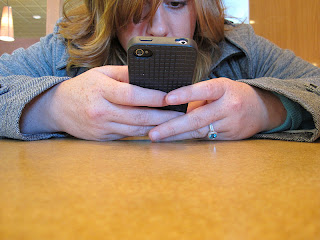 Closeup of Woman texting from Wikimedia Commons