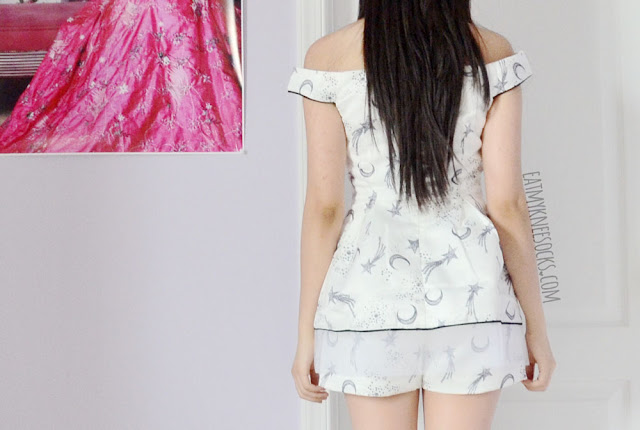 Back view of the moon-and-stars print boat-neck peplum top and high-waisted matching shorts coordinate from SheIn.