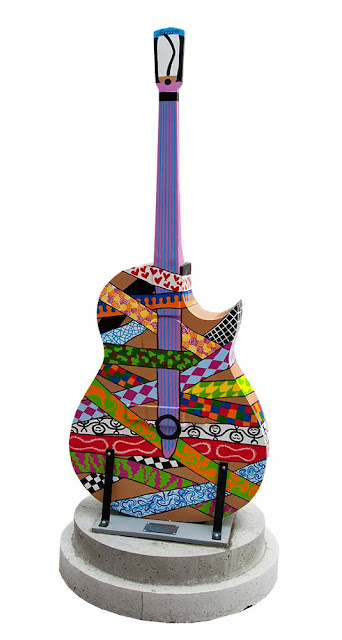dowtown Orillia, outdoor art festival, painted guitars, multicolour abstract design