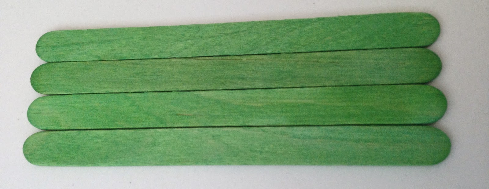 four green  color sticks