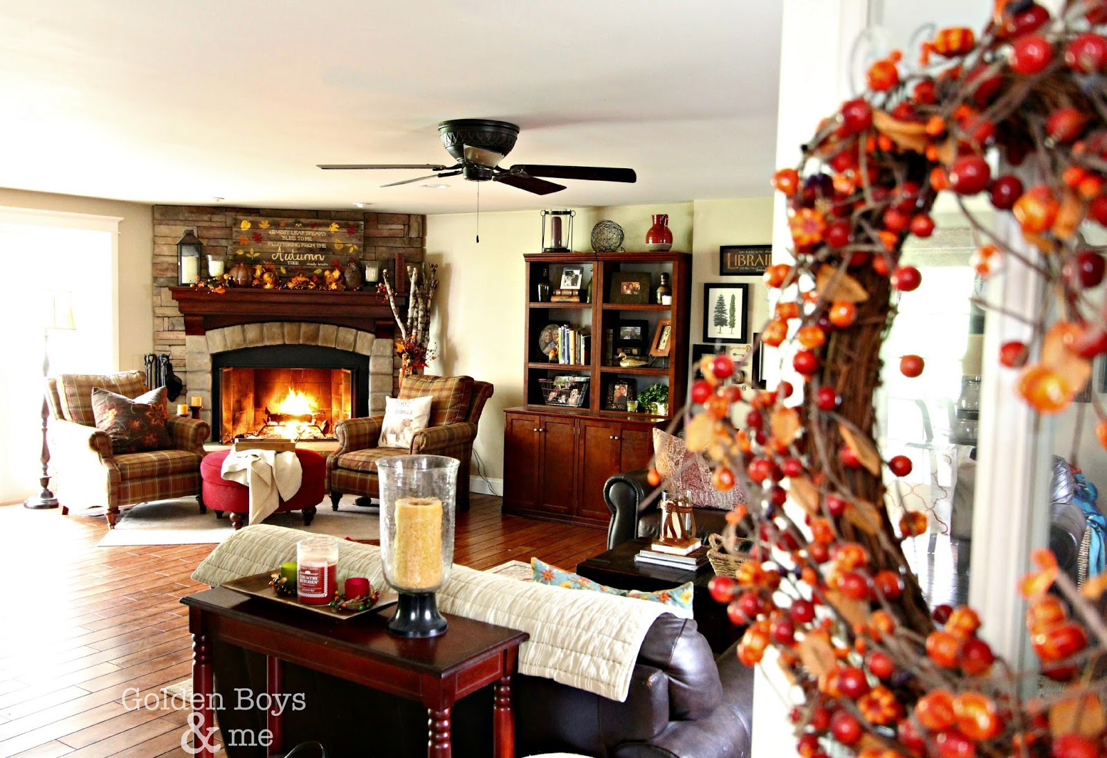 Family room with corner stone fireplace decorated for fall-www.goldenboysandme.com