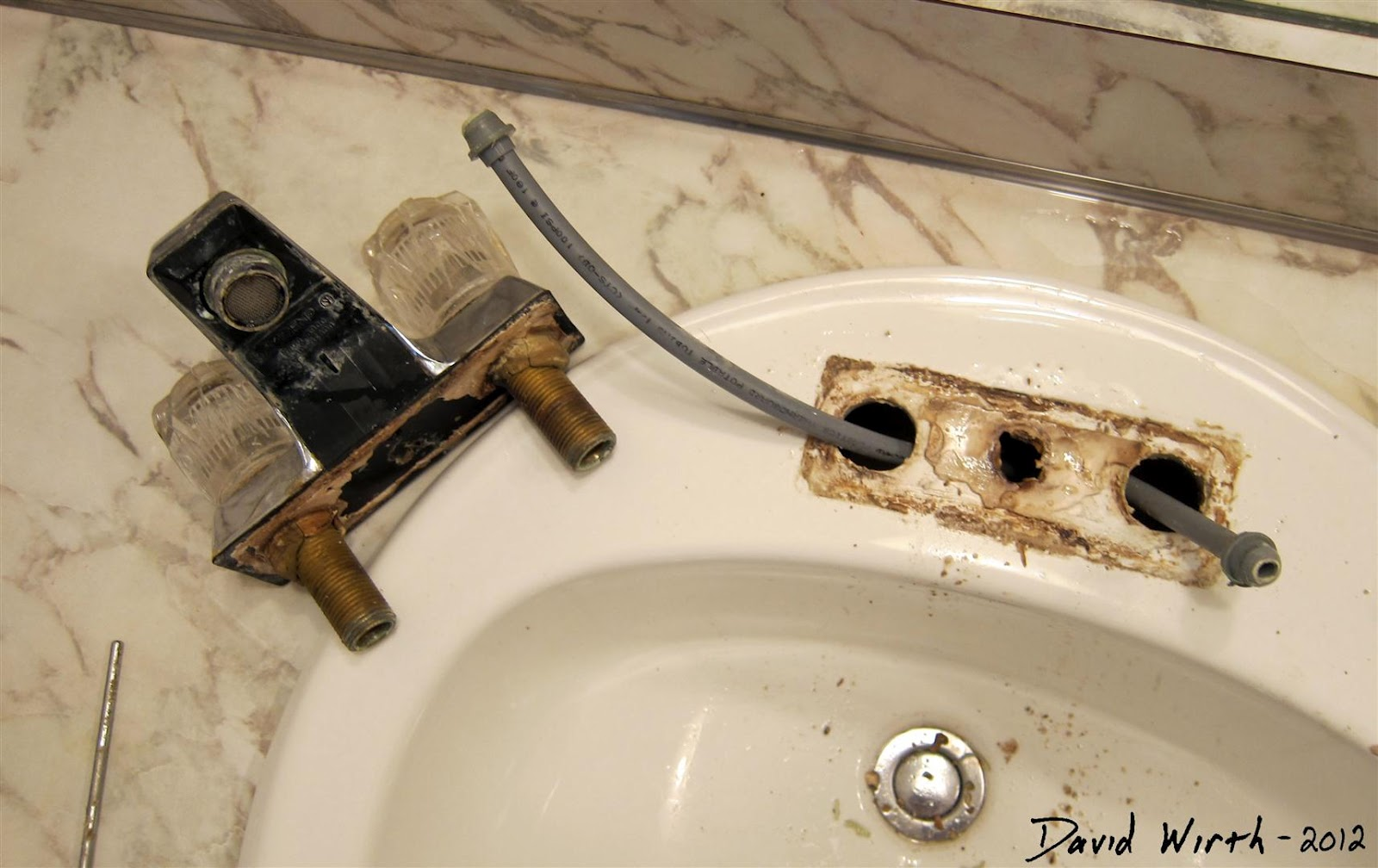 Bathroom sink how to install a faucet for Installing new drain in bathroom sink