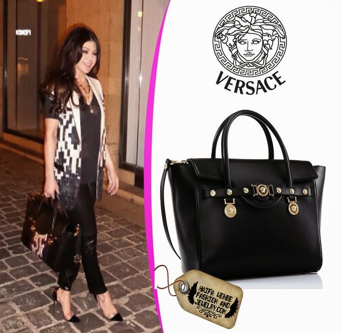 Haifa Wehbe carrying Versace Signature flap handle bag 7d67d427cb