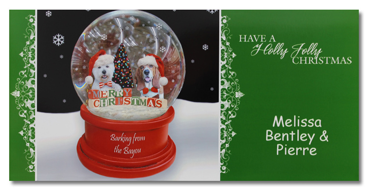 Christmas card with two dogs inside a snowglobe