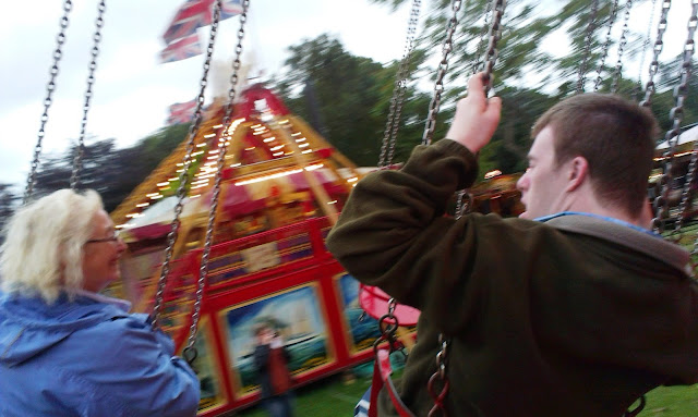 Riding the Chair-o-planes at Carters Steam Fair